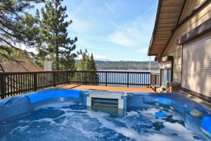 Soak in a hot tub with Big Bear Lake views