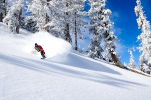 Snowboarder action shot blue sky-2